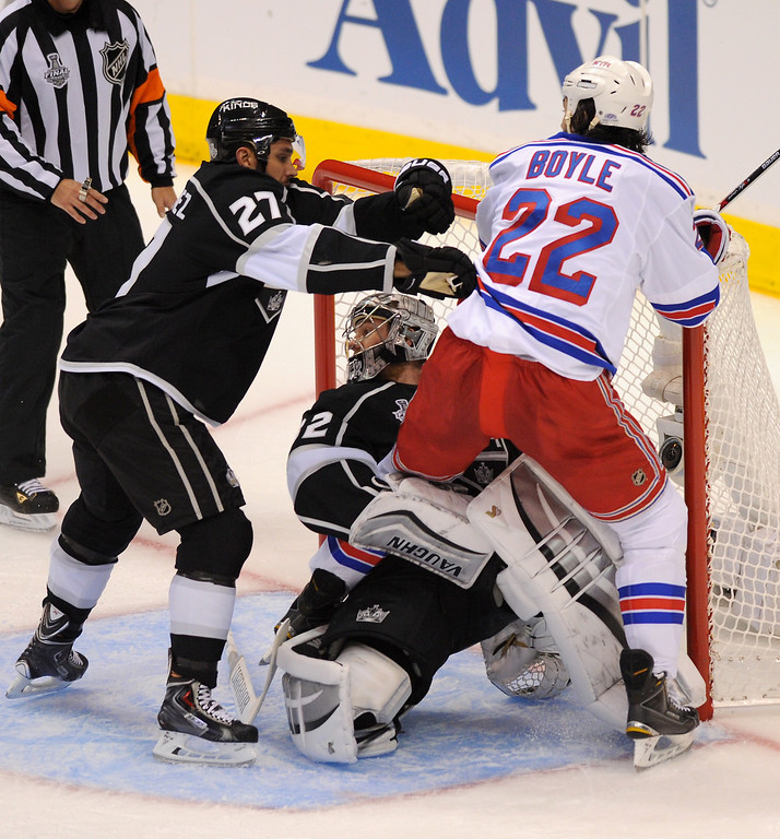 . The Kings\' Alec Martinez pushes the Rangers\' Brian Boyle off Kings\' goalie Jonathan Quick in game two of the Stanley Cup Final, Saturday, June 7, 2014, at Staples Center. (Photo by Michael Owen Baker/Los Angeles Daily News)