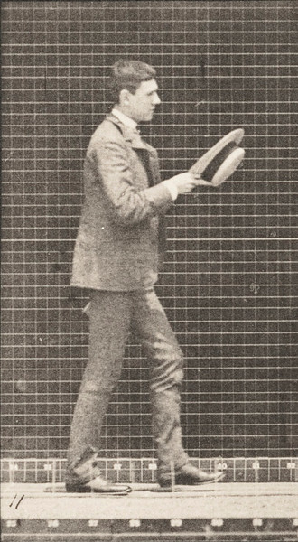 Man walking and taking off a hat