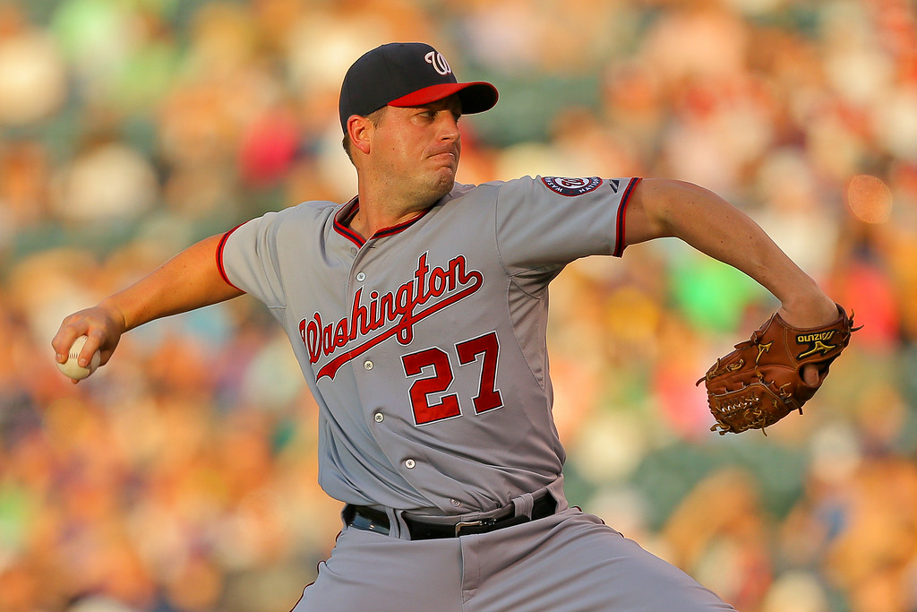 . DENVER, CO - JULY 22:  Starting pitcher Jordan Zimmermann #27 of the Washington Nationals delivers to home plate during the third inning against the Colorado Rockies at Coors Field on July 22, 2014 in Denver, Colorado.  (Photo by Justin Edmonds/Getty Images)