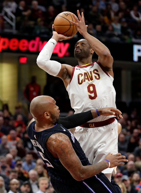 . Cleveland Cavaliers\' Dwyane Wade, right, collides with Orlando Magic\'s Marreese Speights during the first half of an NBA basketball game Thursday, Jan. 18, 2018, in Cleveland. Wade was called for an offensive foul. (AP Photo/Tony Dejak)