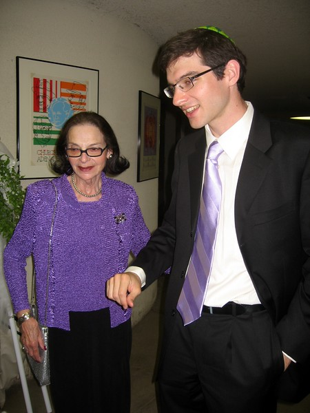 Bernice (grandmother of the bride) greets Hunter (stepbrother of the groom), who will walk her down the aisle