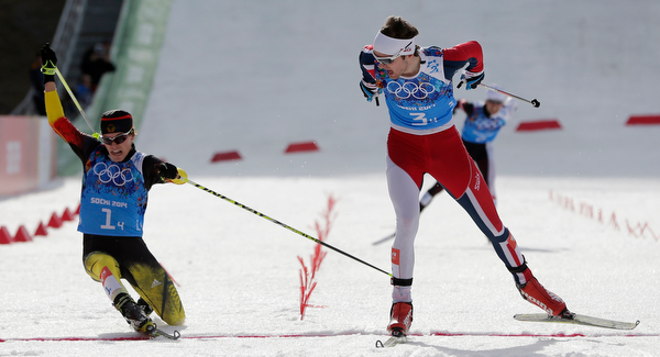 . Norway\'s Joergen Graabak, right, crosses the finish line to win gold ahead of silver medal winner Germany\'s Fabian Riessle, left, during the cross-country portion of the Nordic combined Gundersen large hill team competition at the 2014 Winter Olympics, Thursday, Feb. 20, 2014, in Krasnaya Polyana, Russia. (AP Photo/Matthias Schrader)
