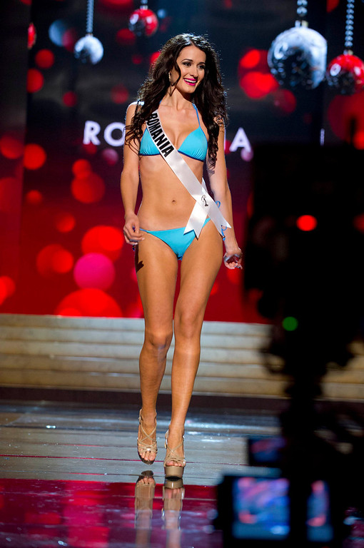 . Miss Romania Delia Monica Duca competes in her Kooey Australia swimwear and Chinese Laundry shoes during the Swimsuit Competition of the 2012 Miss Universe Presentation Show at PH Live in Las Vegas, Nevada December 13, 2012. The 89 Miss Universe Contestants will compete for the Diamond Nexus Crown on December 19, 2012. REUTERS/Darren Decker/Miss Universe Organization/Handout