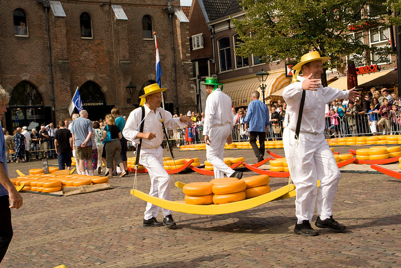 Alkmaar. The different colors of hats, and barges, represent various cheese-runner guilds. I suspect that these days, the guys are doing it for fun. The rest of the week, I imagine a representative from the Albert Heijn grocery chain just calls up a broker, and orders a thousand wheels of Gouda.