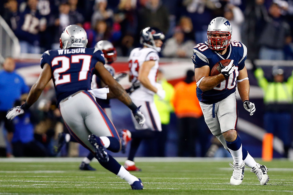 Description of . Rob Ninkovich #50 of the New England Patriots runs with the ball after an interception against the Houston Texans during the 2013 AFC Divisional Playoffs game at Gillette Stadium on January 13, 2013 in Foxboro, Massachusetts.  (Photo by Jared Wickerham/Getty Images)