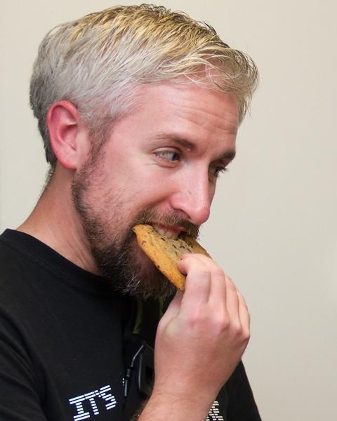 It's cookie time!  Scott keeps an eye on Dan