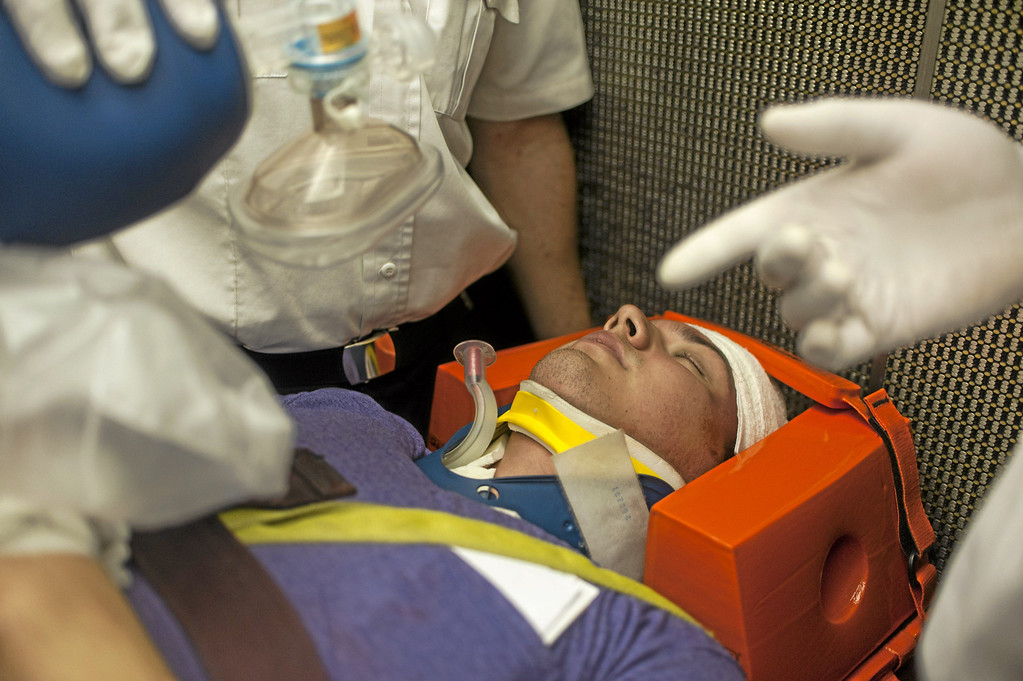 . Theater student Angel Gutierrez, on the stretcher and in the head brace, acts as a car crash victim during a crisis drill at Rio Hondo College in Whittier on Friday, May 9, 2014. (Correspondent Photo by William Camargo)