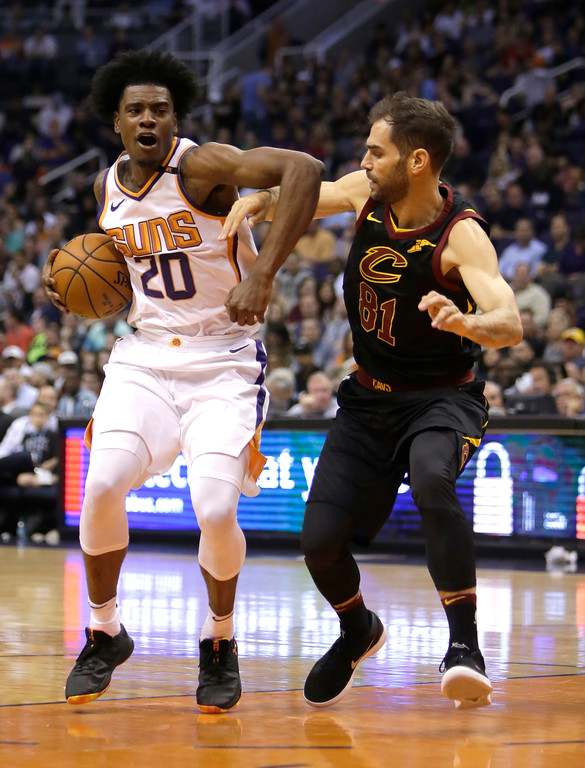 . Phoenix Suns guard Josh Jackson (20) drives on Cleveland Cavaliers guard Jose Calderon in the second half during an NBA basketball game, Tuesday, March 13, 2018, in Phoenix. The Cavaliers defeated the Suns 129-107. (AP Photo/Rick Scuteri)