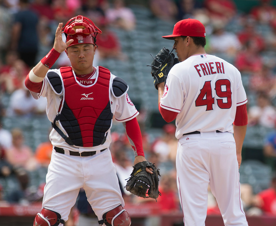 . Angels\' catcher Hank Conger (#16) talks with pitcher Ernesto Frieri as they play the Minnesota Twings at Angel Stadium in Anaheim on Thursday June 26, 2014. The Angels beat the Minnesota Twins 6-4. (Photo by Keith Durflinger/Whittier Daily News)