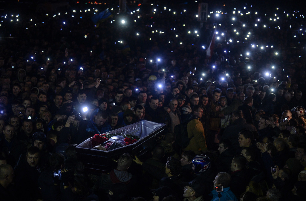 . People carry a coffin of a man who was killed during recent clashes, as they gather at Independence Square on February 22, 2014. AFP PHOTO /BULENT KILIC/AFP/Getty Images