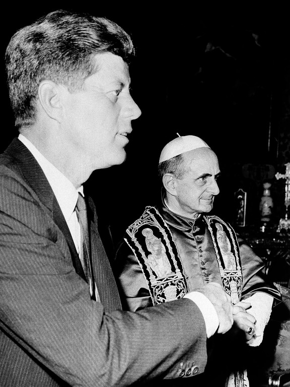 . President John F. Kennedy stands with Pope Paul VI at an audience in the Vatican July 2, 1963.   The pontiff is receiving the first Roman Catholic president.  (AP Photo)