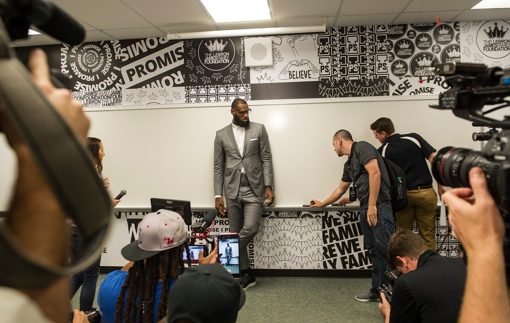 . LeBron James waits as recorders are set before a news conference after the opening ceremony for the I Promise School in Akron, Ohio, Monday, July 30, 2018. The I Promise School is supported by the The LeBron James Family Foundation and is run by the Akron Public Schools. (AP Photo/Phil Long)