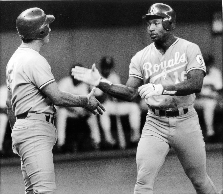 . Bo Jackson of the Kansas City Royals is congratulated at home plate by George Brett after Jackson hit a two run homerun in the first inning, Aug. 17, 1989. The Royals played against the Mariners at the King Dome in Seattle. (AP Photo/Gary Stewart)