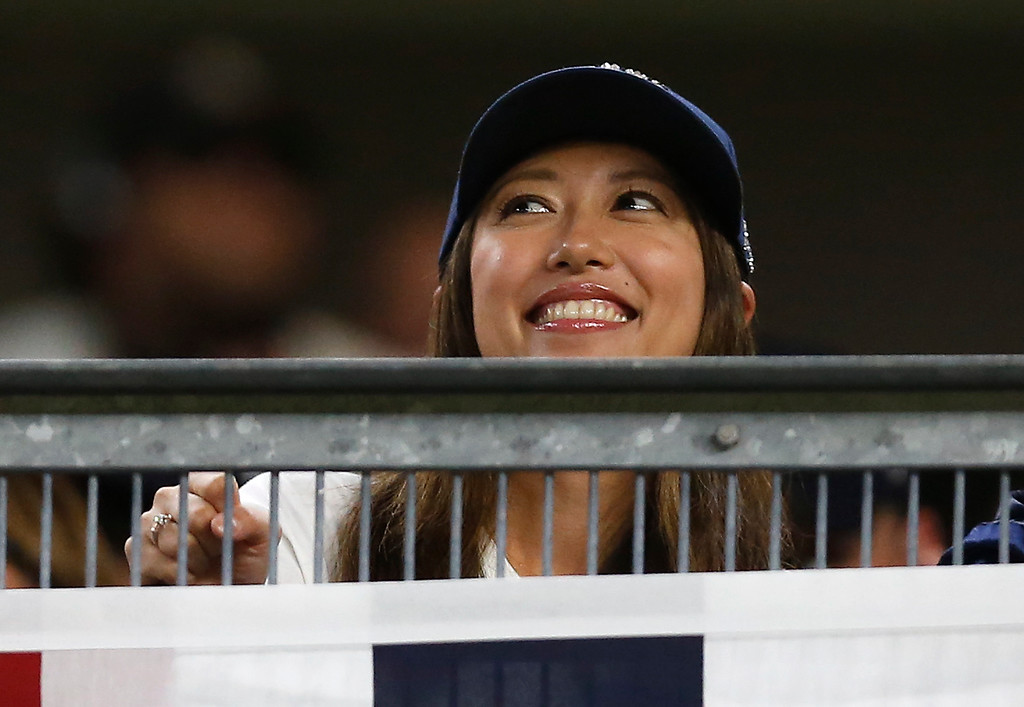 . Mai Satoda, New York Yankees pitcher Masahiro Tanaka\'s wife, watches Game 3 of baseball\'s American League Division Series between the New York Yankees and the Cleveland Indians, Sunday, Oct. 8, 2017, in New York. (AP Photo/Kathy Willens)