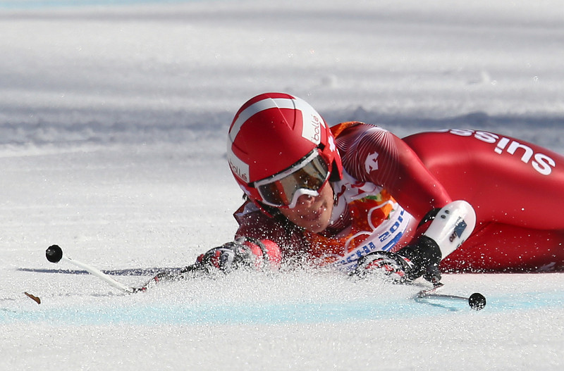 . Switzerland\'s Dominique Gisin falls in the women\'s super-G at the Sochi 2014 Winter Olympics, Saturday, Feb. 15, 2014, in Krasnaya Polyana, Russia. (AP Photo/Alessandro Trovati)