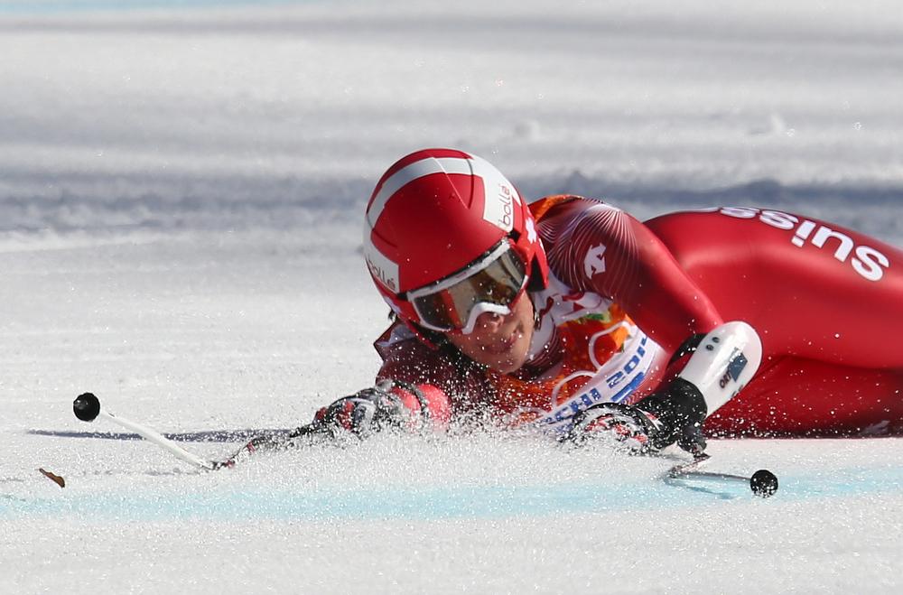 . Switzerland\'s Dominique Gisin falls in the women\'s super-G at the Sochi 2014 Winter Olympics, Saturday, Feb. 15, 2014, in Krasnaya Polyana, Russia. (AP Photo/Alessandro Trovati)