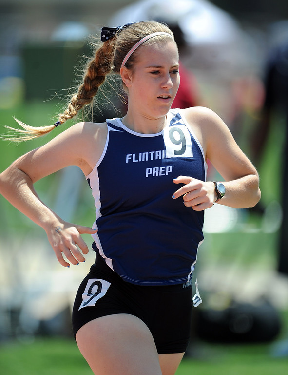 . Flintridge Prep\'s Kate Evans in the 1600 meters race during the CIF-SS track & Field championship finals in Hilmer Stadium on the campus of Mt. San Antonio College on Saturday, May 18, 2013 in Walnut, Calif.  (Keith Birmingham Pasadena Star-News)