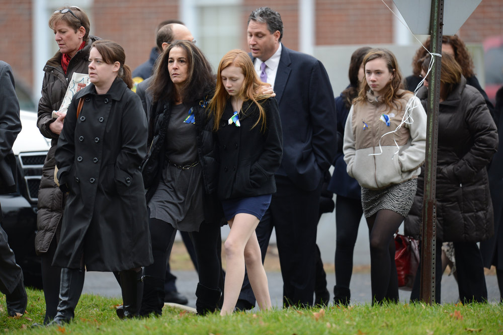 Description of . Mourners leave after Noah Pozner's funeral December 17, 2012 at the Abraham L. Green and Son Funeral Home in Fairfield, Connecticut. Pozner, a six year-old Jewish boy who, along with 19 other classmates and 6 teachers was murdered by a lone gunman December 14 at the Sandy Hook Elementary School in Newtown, Connecticut.  AFP PHOTO / Don  EMMERT/AFP/Getty Images