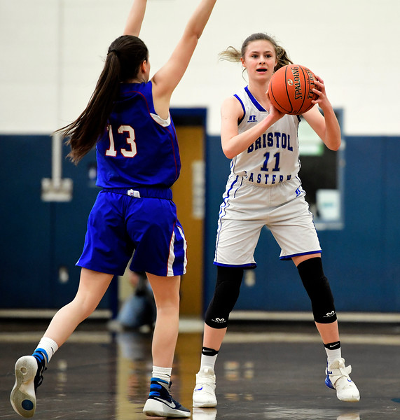 2/9/2019 Mike Orazzi | Staff Bristol Eastern's Ciara Collins (11) and Rocky Hill's Olivia Augeri  (13) during Saturday's girls basketball game in Bristol.