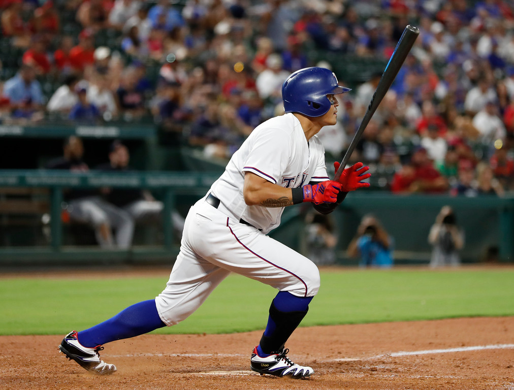 . CORRECTS TO EIGHTH INNING, INSTEAD OF NINTH - REMOVES REFERENCE TO SINGLE - Texas Rangers\' Shin-Soo Choo follows through on a ground ball during the eighth inning of the team\'s baseball game against the Cleveland Indians, Saturday, July 21, 2018, in Arlington, Texas. Willie Calhoun was out at second, and Choo was safe at first. (AP Photo/Jim Cowsert)