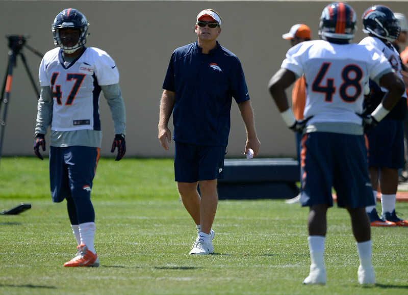 . Denver Broncos defensive coordinator Jack Del Rio runs drill with the defense during practice August 25, 2014 at Dove Valley.(Photo by John Leyba/The Denver Post)