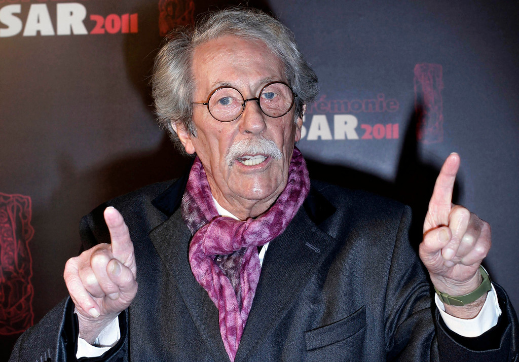 . FILE - In this Feb. 25, 2011 file photo, French actor Jean Rochefort gestures as he arrives at the 36th French Cesar Awards Ceremony in Paris. Rochefort, who starred in more than 100 films and made French audience laugh and cry over the past 50 years with his comical roles and appealing personality, died Oct. 9. He was 87. (AP Photo/Thibault Camus, File)