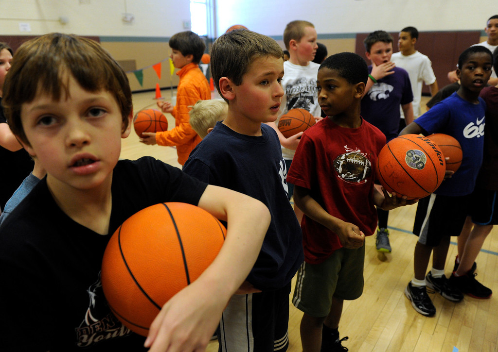 . DENVER, CO. - FEBRUARY 23: The group of kids line up to begin the competition. The Tamarac Optimist Club sponsors one of the Tri-Star Basketball Competitions at the Eisenhower Recreation Center in Denver. The competitions are held over a several week period for boys and girls 8-13 years-old. The winners from this competition go on to the regional finals, and those winners will play in the final competition on Mar. 23, 2013 at the Pepsi Center before a Nuggets game. There are still several opportunities for kids to try out. Go to www.tristarbasketball.org for upcoming times and locations. (Photo By Kathryn Scott Osler/The Denver Post)