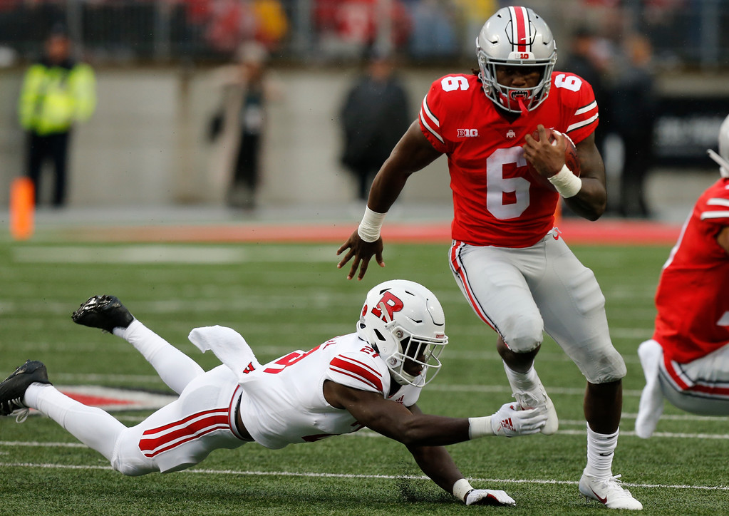 . Ohio State running back Brian Snead, right, cuts up field against Rutgers defensive back Tim Barrow during the second half of an NCAA college football game Saturday, Sept. 8, 2018, in Columbus, Ohio. Ohio State beat Rutgers 52-3. (AP Photo/Jay LaPrete)