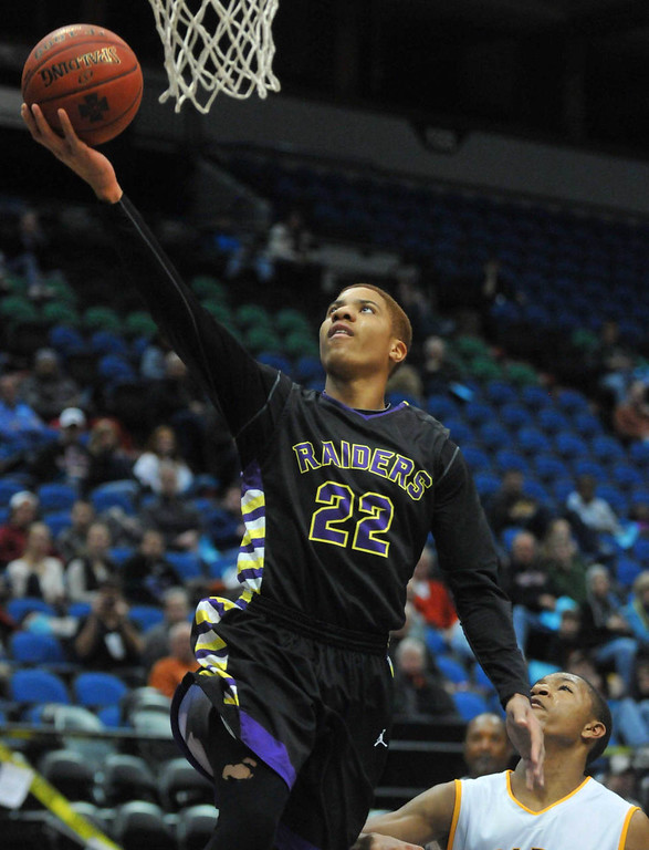 . Cretin-Derham Hall\'s Donnell Gresham goes up for two points in the first half.(Pioneer Press: Scott Takushi)