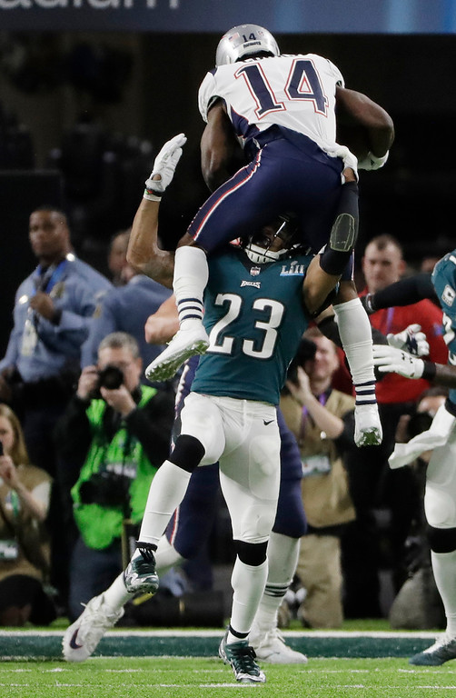 . New England Patriots wide receiver Brandin Cooks (14), leaps over Philadelphia Eagles free safety Rodney McLeod (23), during the first half of the NFL Super Bowl 52 football game, Sunday, Feb. 4, 2018, in Minneapolis. (AP Photo/Chris O\'Meara)