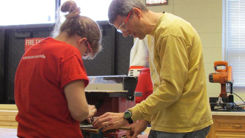 Mr. Hoggatt and Annalyssa working on bending.