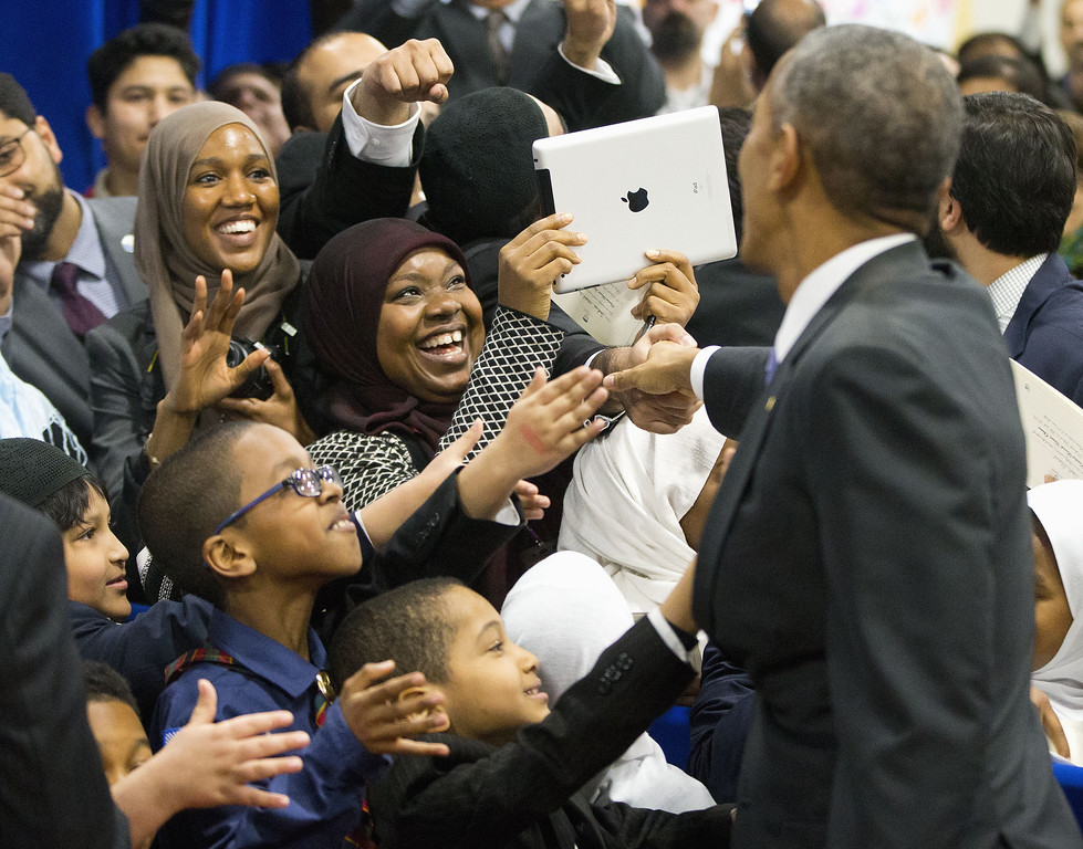 . President Barack Obama greets children from Al-Rahmah school and other guests during his visit to the Islamic Society of Baltimore, Wednesday, Feb. 3, 2016, in Baltimore, Md. Obama is making his first visit to a U.S. mosque at a time Muslim-Americans say they\'re confronting increasing levels of bias in speech and deeds.(AP Photo/Pablo Martinez Monsivais)