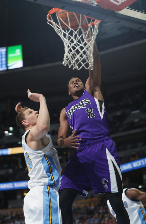 . Sacramento Kings forward Rudy Gay, right, dunks ball over Denver Nuggets center Timofey Mozgov in the first quarter of an NBA basketball game in Denver, Sunday, Feb. 23, 2014. (AP Photo/David Zalubowski)