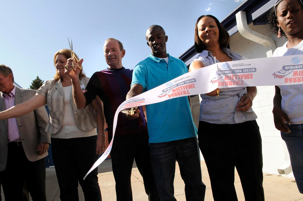 . Denver Broncos owner Pat Bowlen,  third from left, Denver Broncos player Dominique Foxworth and Darrent William\'s mother Rosalind Williams cut a ribbon to officially open the Darrent Williams Memorial Teen Center in 2008. Helen H. Richardson/The Denver Post