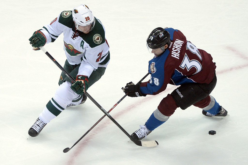 . DENVER, CO - APRIL 26: Ryan Suter (20) of the Minnesota Wild and Joey Hishon (38) of the Colorado Avalanche battle for the puck during the second period. The Colorado Avalanche hosted the Minnesota Wild during game five of the first round of the NHL Stanley Cup Playoffs at the Pepsi Center on Saturday, April 26, 2014. (Photo by Karl Gehring/The Denver Post)