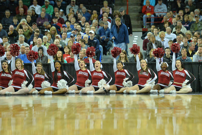 March 20, 2014: The Harvard Crimson cheerleaders perform during a second round game of the NCAA Division I Men's Basketball Championship between the 5-seed Cincinnati Bearcats and the 12-seed Harvard Crimson at Spokane Arena in Spokane, Wash. Harvard defeated Cincinnati 61-57.