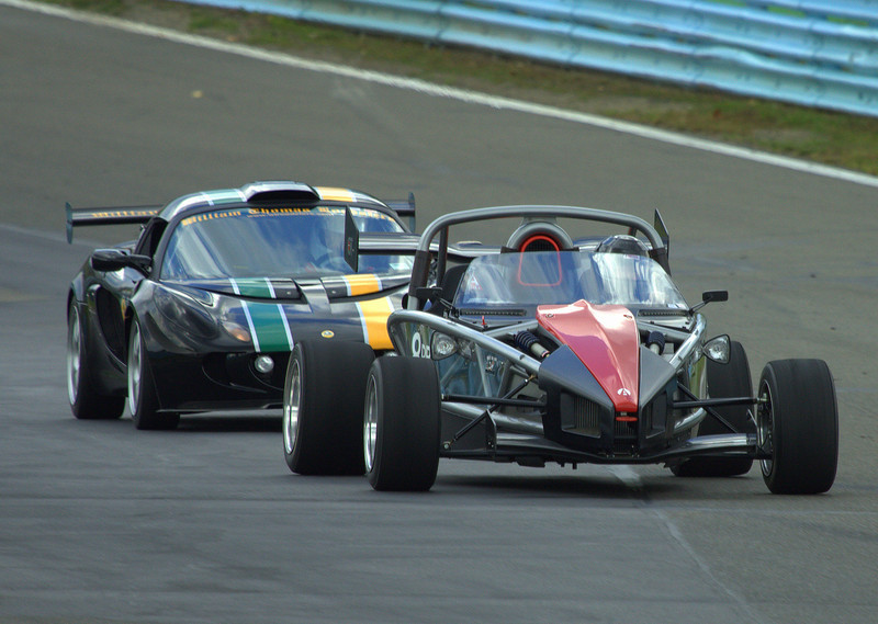 """Ariel Atom 2 in the lead over a Lotus Exige Cup Car, coming up through the """"Esses"""" at Watkins Glen International"""