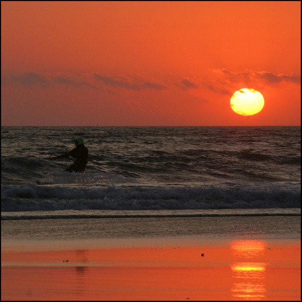 Kite surfer at sunset. San Mateo coast.