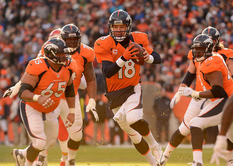 . Denver Broncos quarterback Peyton Manning (18) scrambles out of the pocket in the first quarter as the Denver Broncos took on the Kansas City Chiefs at Sports Authority Field at Mile High in Denver, Colorado on December 30, 2012. John Leyba, The Denver Post