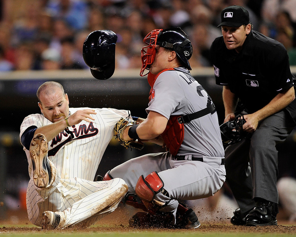 . Ryan Doumit of the Twins is out as Boston catcher Ryan Lavarnway defends home plate and umpire Paul Schrieber watches the play during the sixth inning Saturday, May 18, 2013, at Target Field. The Twins lost to the Red Sox 12-5. (Photo by Hannah Foslien/Getty Images)