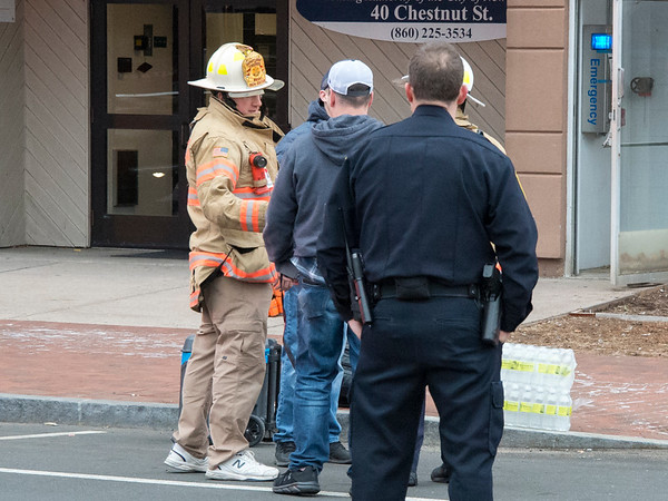 01/31/20 Wesley Bunnell | StaffrrA fire occurred at 40 Chestnut St on Friday afternoon January 31, 2020 requiring one person to be taken by ambulance for smoke inhalation. Fire officials stand near the main entrance.