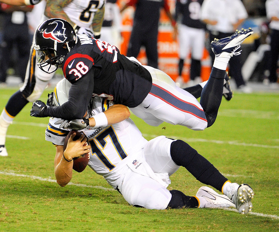 . Houston Texans free safety Danieal Manning, top, sacks San Diego Chargers quarterback Philip Rivers during the first half of an NFL football game Monday, Sept. 9, 2013, in San Diego. (AP Photo/Denis Poroy)