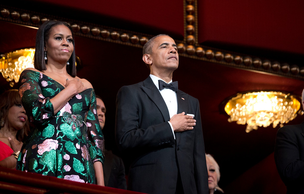 . President Barack Obama and first lady Michelle Obama, put their hand over their heart as the national anthem is sang during the Kennedy Center Honors Gala at the Kennedy Center in Washington, Sunday, Dec. 4, 2016. (AP Photo/Manuel Balce Ceneta)