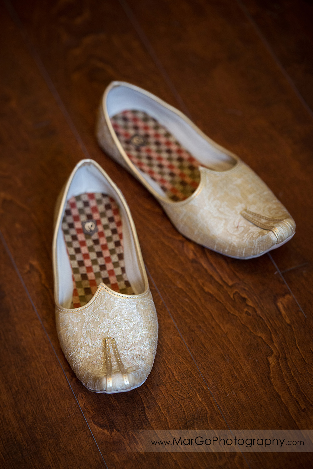 Indian wedding shoes for groom on wooden floor at Elliston Vineyards in Sunol
