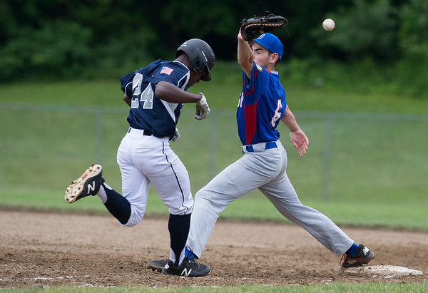06/19/19 Wesley Bunnell | Staff Berlin Legion vs Newington at Legends Field in Newington on June 19, 2019. X Mitchell (8) is safe on throw past the first baseman Vince Dastoli (6).