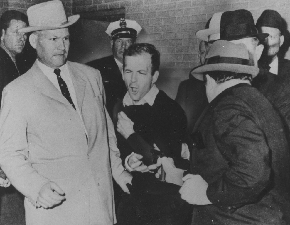 . Oswald winces as Ruby, foreground, shoots him from point blank range in a corridor of Dallas police headquarters on Nov. 24, 1963. The plainclothes policeman at left is J.A. Leavelle. Bob Jackson,  Dallas Times Herald