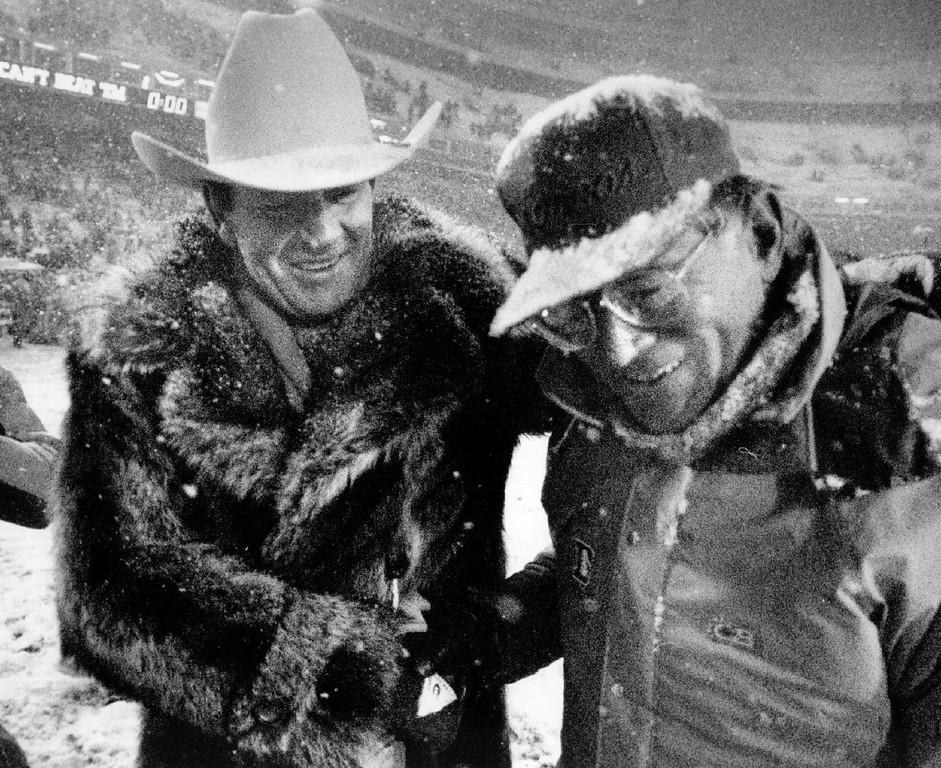 . Denver Broncos owner Pat Bowlen congratulates head coach Dan Reeves after a game.  Denver Post Library photo archive
