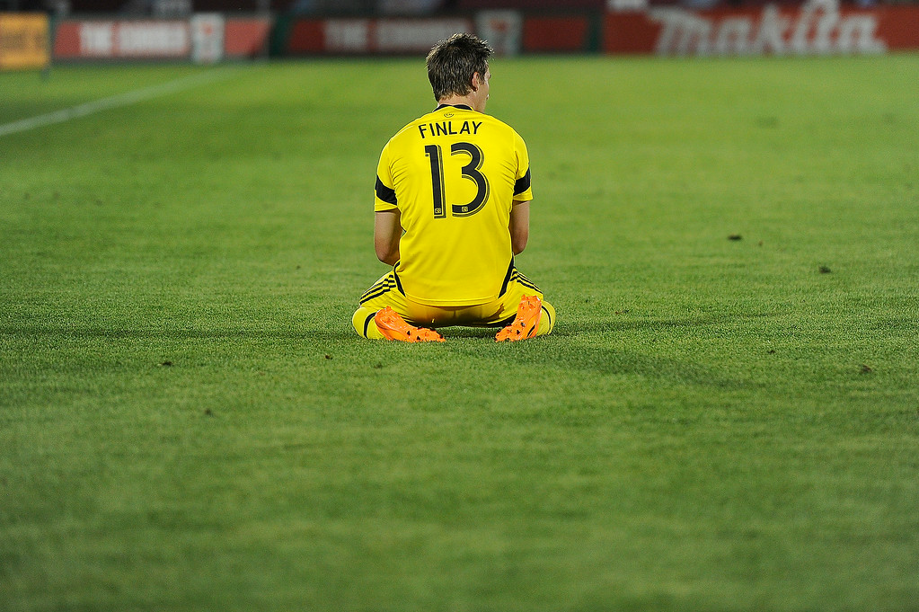 . Ethan Finlay #13 of the Columbus Crew reacts after a go-ahead goal was called back because of an off side player against the Colorado Rapids during an MLS match at Dick\'s Sporting Goods Park on July 4, 2014, in Commerce City, Colorado. (Photo by Daniel Petty/The Denver Post)