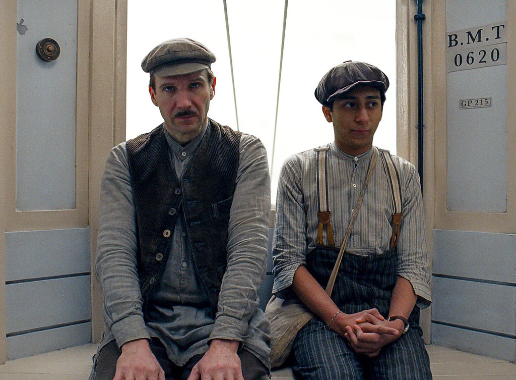 """. This image released by Fox Searchlight shows Ralph Fiennes, left, and Tony Revolori in \""""The Grand Budapest Hotel .\""""  Fiennes was nominated for a Golden Globe for best actor in a comedy or musical for his role in the film on Thursday, Dec. 11, 2014. The 72nd annual Golden Globe awards will air on NBC on Sunday, Jan. 11. (AP Photo/Fox Searchlight)"""