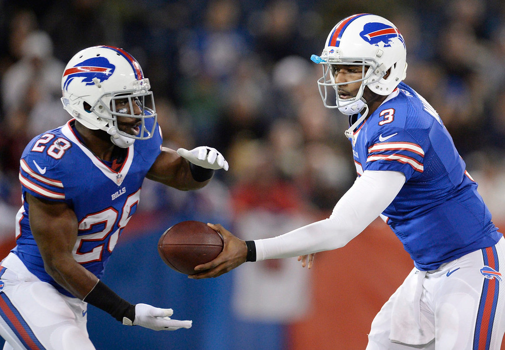 . Buffalo Bills quarterback EJ Manuel hands off to running back C.J. Spiller during first half NFL action against the Atlanta Falcons in Toronto on Sunday, Dec. 1, 2013. (AP Photo/The Canadian Press, Frank Gunn)